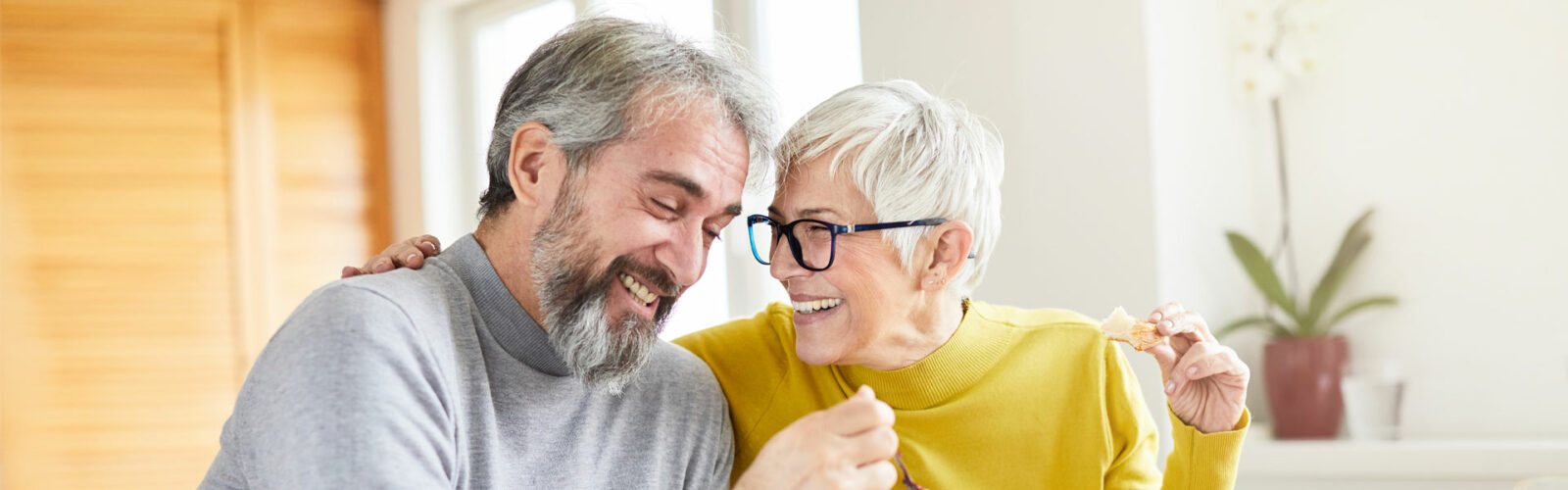 mid aged couple laughing