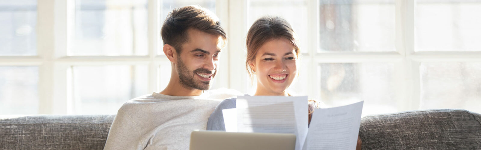 couple reading insurance form