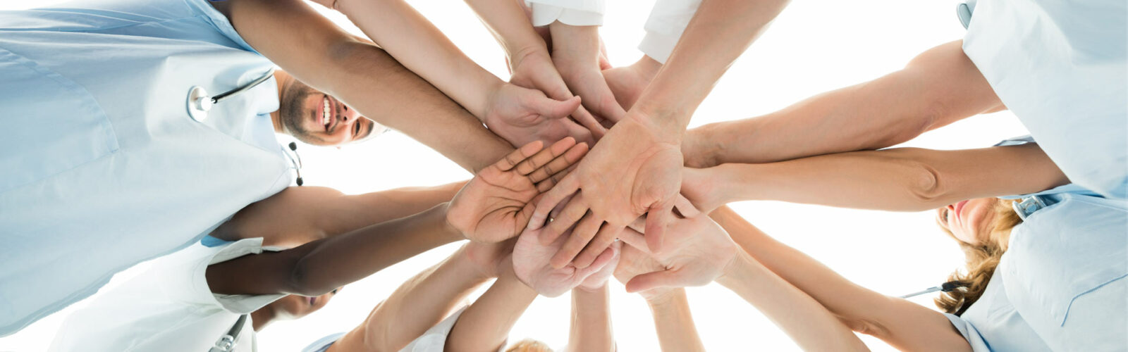 showing unity with hands on each other